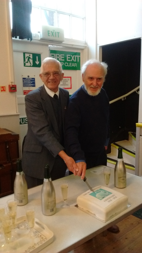 Albert Aldred (He judged the National) on the left, and Harry Nicholson (he judged the special classes for coat and type) cut the Centenary cake.